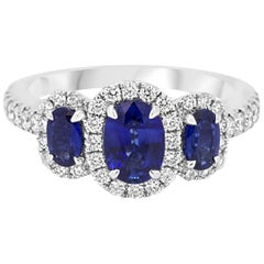 Blue Sapphire Diamond Three-Stone Halo Gold Ring