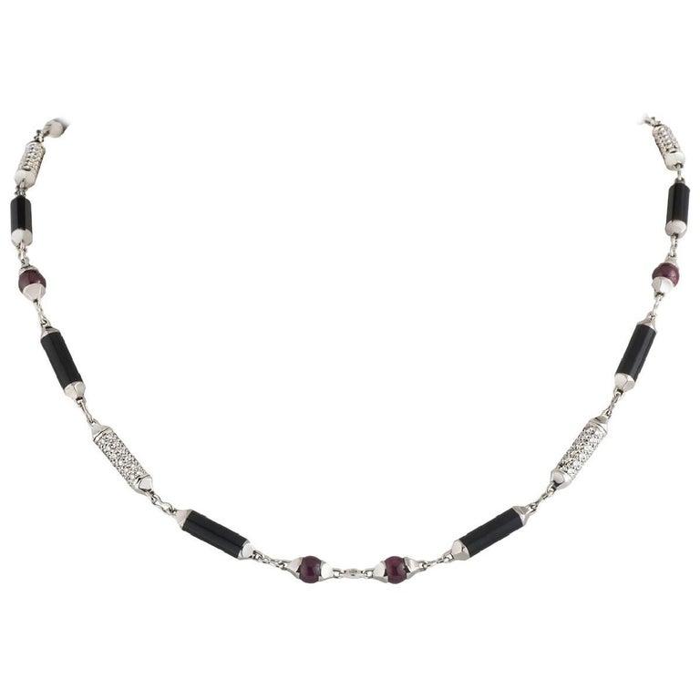 Cartier Diamond, Onyx and Ruby Le Baiser Du Dragon Necklace