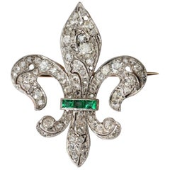 Emerald and Diamond Gold and Platinum Fleur-de-Lis Brooch