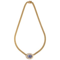 Carved Sapphire Embellished with Pavè Diamond
