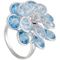 Topaz and Diamond White Gold Flower Ring