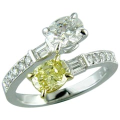 One Fancy Platinum Swirl Yellow and White Oval Diamond Ring