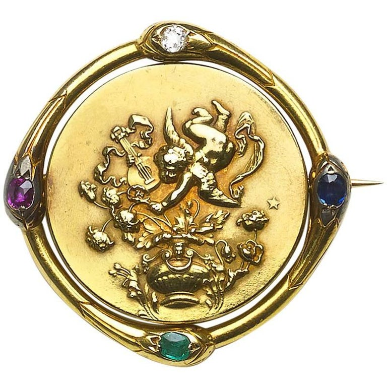 French Gold Spinning Cherub Brooch