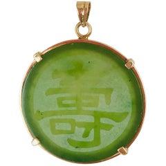 Jadeite, Translucent 14 Karat Gold Pendant, circa 1950s