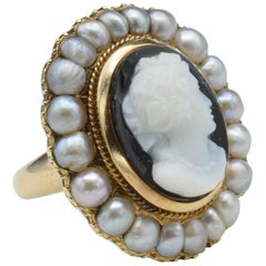 Hand-Carved Onyx Cameo Ring with Pearl Halo from Napoleon III in 18 Karat Gold