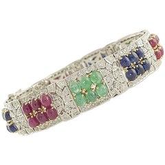 Diamonds 4.10 Carat, Rubies Blue Sapphires Emeralds 33.13 Carat Gold Bracelet