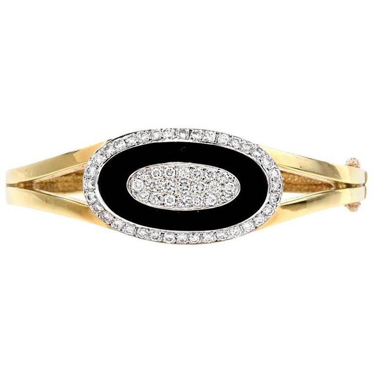1960s Diamond Onyx 18 Karat Yellow Gold Bangle Bracelet