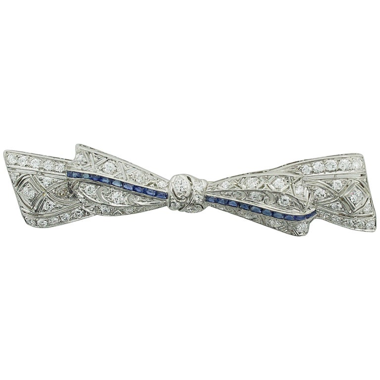 1920s Exquisite Platinum Diamond and Sapphire Bow Brooch