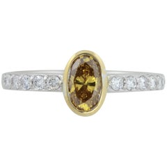 GIA Certified .56 ct Orange Yellow Oval Diamond In 18kt Two Tone Diamond Ring