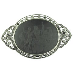 "Signed ""Putti"" Platinum Black Onyx Brooch or Pendant, circa 1920"
