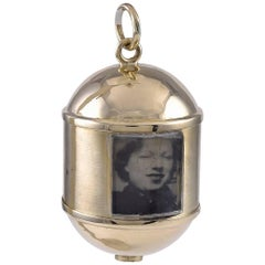 Gold Spinning Locket for Eight Pictures