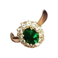 1.03 Carat Oval Cut Colombian Emerald 18 Karat Gold Diamond Halo Engagement Ring
