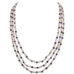 14 Karat Yellow Gold Triple Strand Amethyst and Clear Beaded Necklace