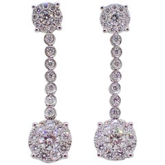 18 Karat Gold Dangle Earrings with 1.47 Carat of Round Brilliant Cut Diamonds