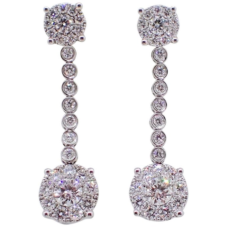 18 Karat Gold Dangle Earrings with 1.47 Carat of Round Brilliant Cut Diamonds