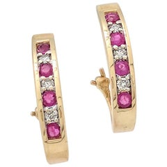 14 Karat Gold Ruby and Diamond Channel Set Earrings with Omega Back 1.44 Carat