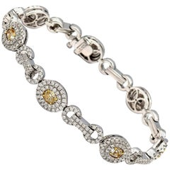 2.33 Carat Seven Oval Shaped Fancy Light Yellow Diamonds Bracelet 18 Karat Gold