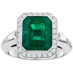4.58 Carat Green Emerald and Diamond Halo Ring