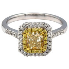 0.97 Carat Radiant Natural Yellow Diamond Ring in 18 Karat White Gold