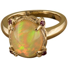 Ethiopian Opal and Burmese Ruby Cocktail Ring in 14 Karat Yellow Gold