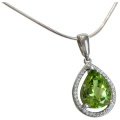 3.57 Carat Pear Shaped Peridot with Diamond Halo Pendant 14 Karat White Gold