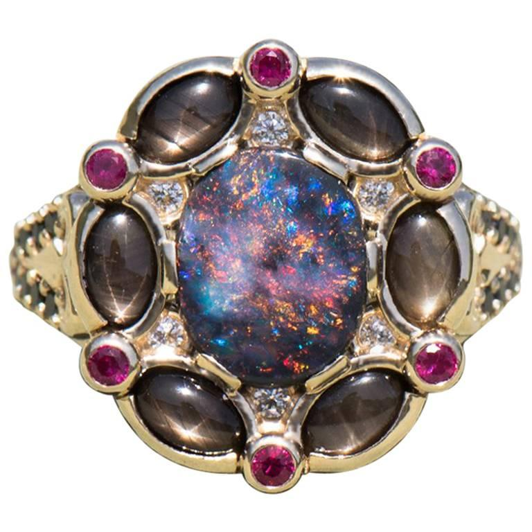 Black Opal Ring Surrounded by Black Star Sapphires, Diamonds and Burmese Rubies