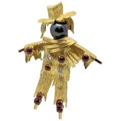 14 Karat Yellow Gold Scarecrow Brooch Has Black Cultured Pearl; Diamonds; Rubies