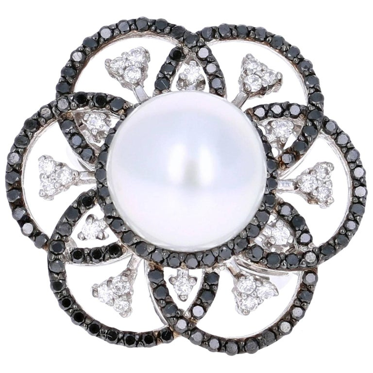 A Gorgeous 1.31 carat South Sea Pearl, Black and White Diamond Cocktail ring that is sure to elevate your look!  There is a beautiful South Sea Pearl in the center of the ring followed by petal like alternating black and white diamonds that are set