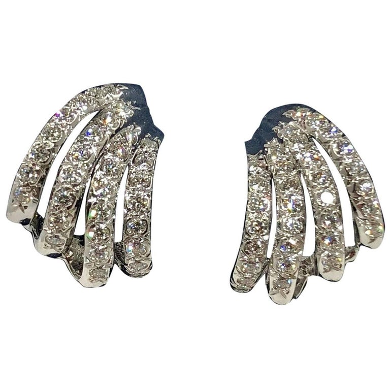 Henry Dankner and Sons 18 karat white gold and diamond climber earrings. Created by Henry Dankner & Sons, this stunning pair of earrings are designed with 64- full cut round diamonds equaling 1.50 carat approximate total weight, average color G-H,