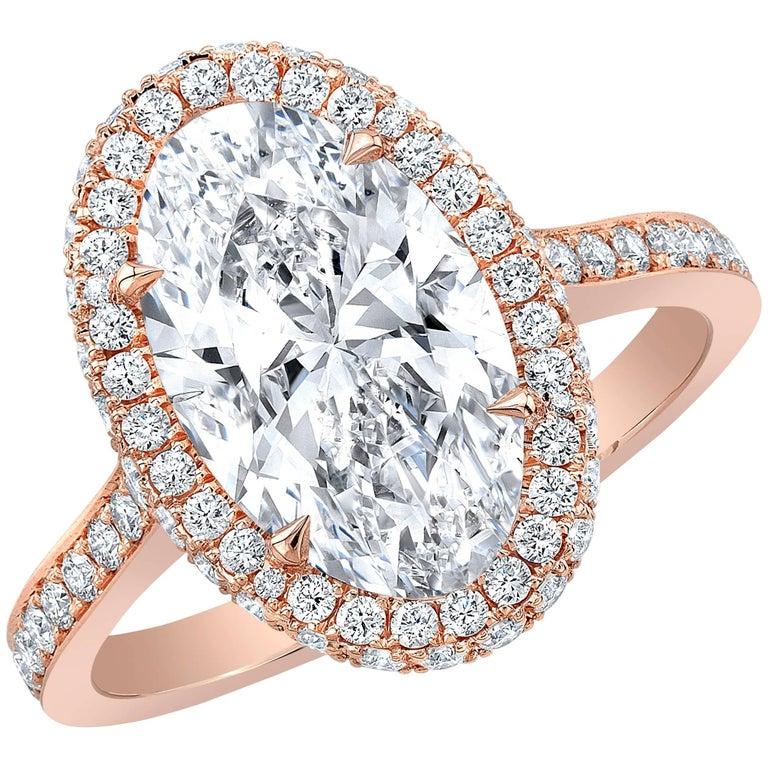 GIA Certified 3.29 Carat D VS2 Oval Diamond 18 Karat Rose Gold Halo Ring For Sale