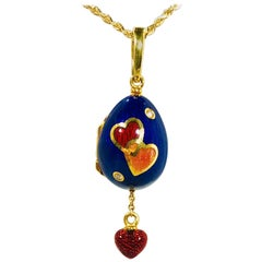 Faberge by Victor Mayer 18 Karat and Enamel Diamond Egg Locket Pendant