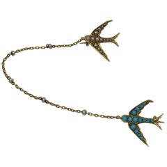 Victorian Turquoise Pearl and 15 Karat Swallow Brooch
