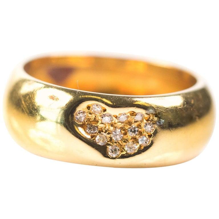 Tiffany and Co. 0.15 Carat Diamond and 18 Karat Yellow Gold Heart Ring