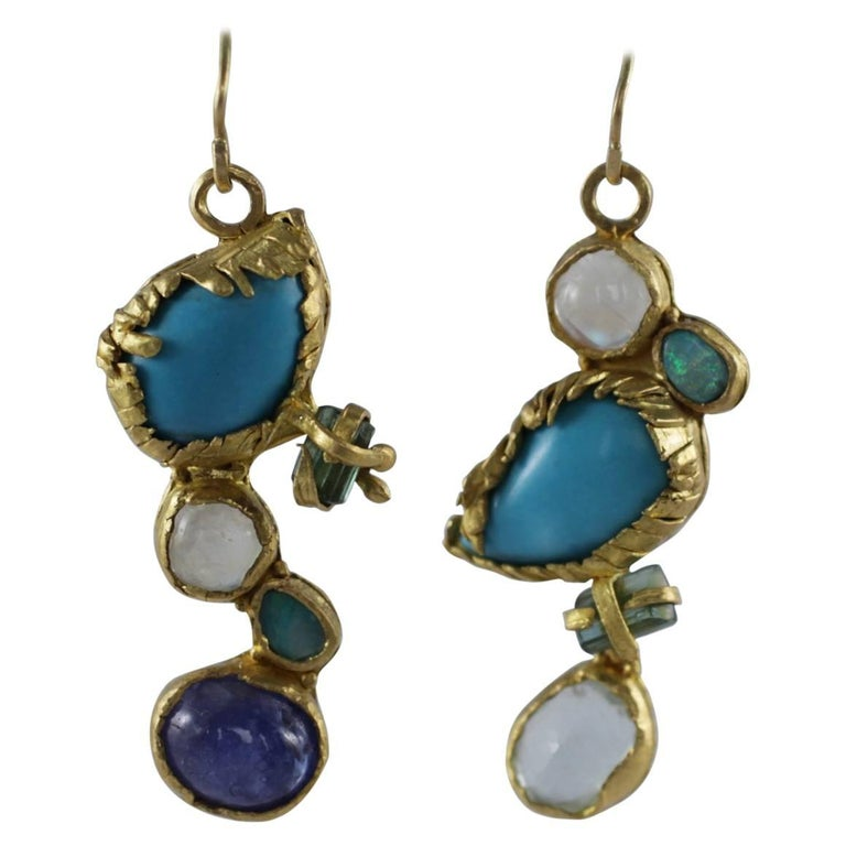 Birds, dangle drop earrings. Turquoise, moonstone, tourmaline crystals, opal, and tanzanite are set in 21K gold bezel. One-of-a-kind, handmade. Feminine and exotic, these will surely start a conversation.  The inspiration for these dangle drop