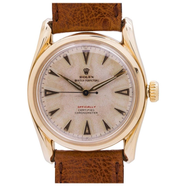 Rolex Yellow Gold Bombe Red Officially self winding wristwatch, circa 1951