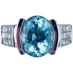 Oval 5.00 Carat Paraiba, 18 Karat, 1.05 Carat V.S Quality Princess Diamonds