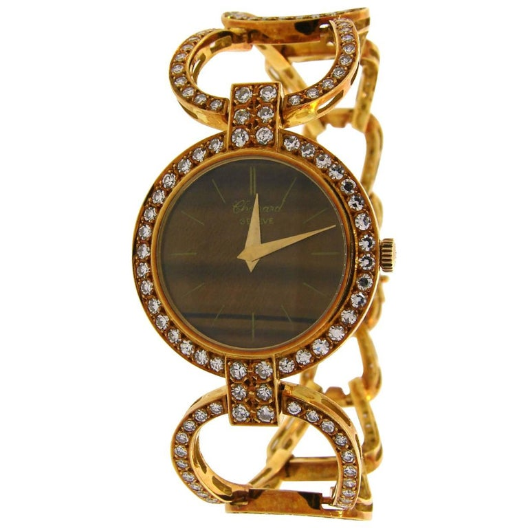 Beautiful feminine watch created by Chopard in the 1970s. Tasteful combination of earthy colored Tiger's Eye and yellow gold with splashes of sparkly diamonds, perfect proportions and light openwork design are the highlights of this lovely vintage