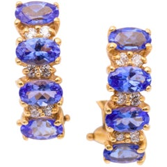 Oval Cut Tanzanite and Diamond Huggies Earrings 14K