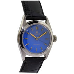 Rolex Stainless Steel Oyster Blue Dial Mid Size Manual Wind Watch, circa 1951