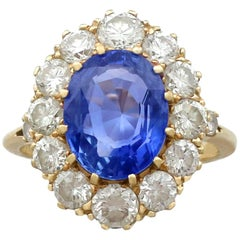 1980s 4.10 Carat Ceylon Sapphire 1.75 Carat Diamond 18 Karat Gold Dress Ring