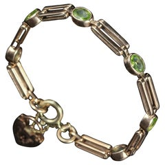 Antique Victorian Peridot Gate Bracelet 9 Carat Rose Gold, circa 1890