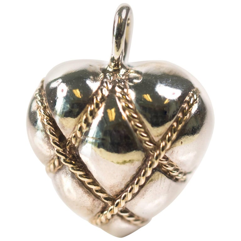 Tiffany & Co. Sterling Silver, 14 Karat Yellow Gold Puffed Heart Pendant Charm
