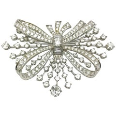 7.67 Carat Round and Baguette Diamond Platinum Spray Bow Brooch