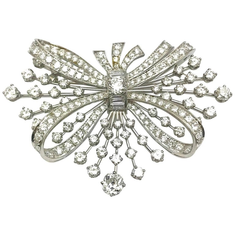 7.67 Carat Round and Baguette Diamond Platinum Spray Bow Brooch For Sale