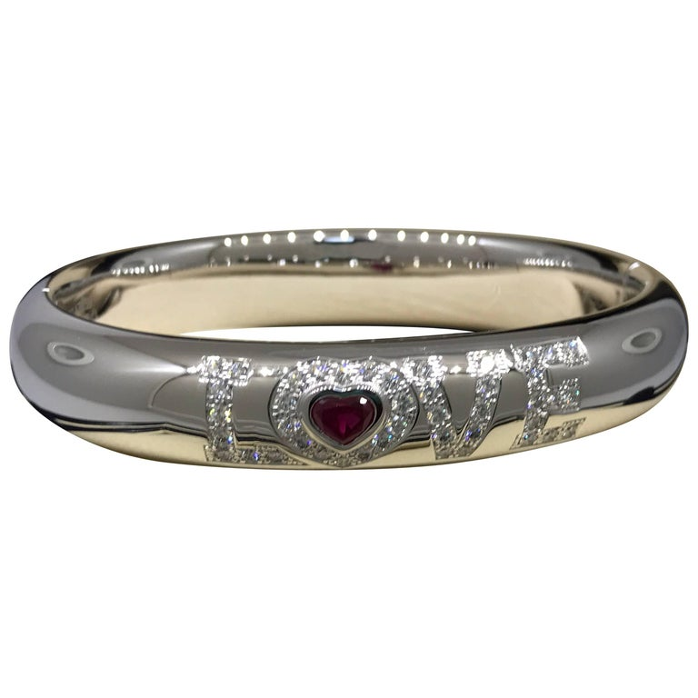 "Chopard ""LOVE"" 18 Karat White Gold Diamond and Ruby Bangle Bracelet 85/3418-1003"