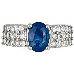 Oval Blue Sapphire, 1.60 Carat Set in Contemporary, 18 Karat Diamond Ring