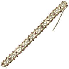 Gubelin Ruby and Diamond Bracelet in 18 Karat Yellow Gold, circa 1950s
