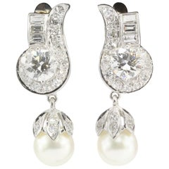 Retro Platinum Diamond and Pearl Drop Earrings