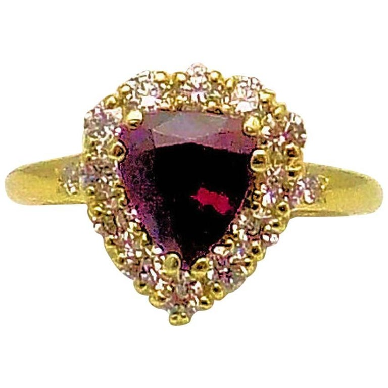 18 Karat Yellow Gold Pear Shape Ruby and Diamond Ring For Sale