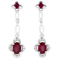 2.45 Carat Oval Ruby and .28 Carat Diamond Earrings